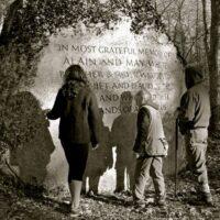 memorial rock with people