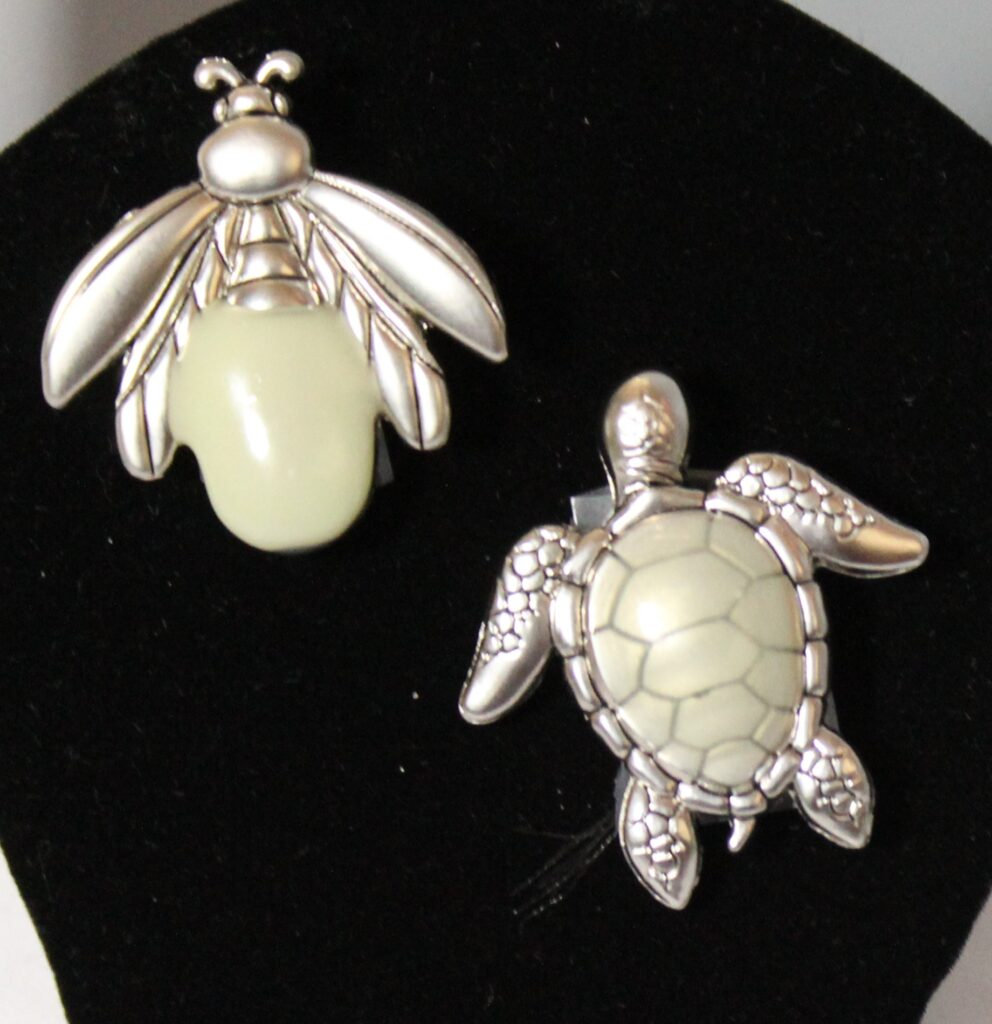Fire fly and sea turtle charm